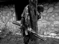 @1995 Emmanuel Ortiz. A Bosniak soldier cries after arriving to his home village, 3 years early he had hid in the forest and watched his family and the rest of the village executed by Bosnian Serb forces.